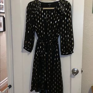 Black and gold blouse dress with cut out details